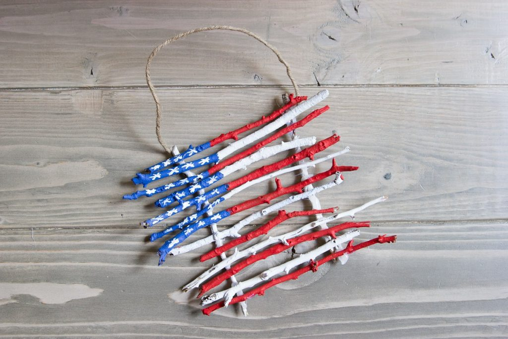 Painted stick flags, great nature craft for kids for 4th of July or Memorial Day #4thofjuly #craftsforkids